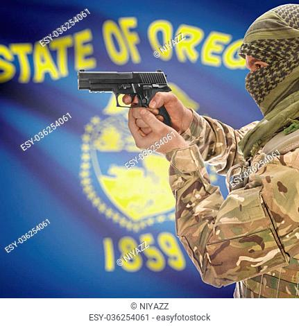 Male in muslim keffiyeh with gun in hand and flag on background series - Oregon
