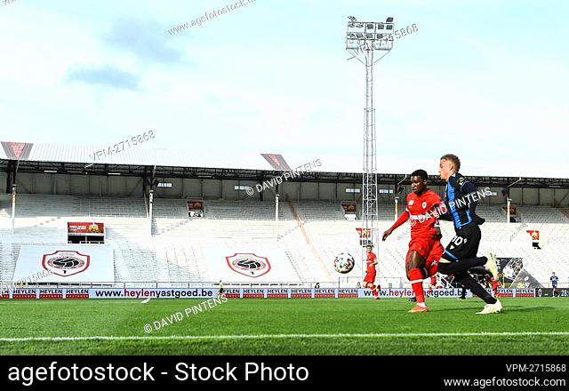 Antwerp's Aurelio Buta and Club's Noa Lang pictured in action during a soccer match between Royal Antwerp FC and Club Brugge, Thursday 13 May 2021 in Antwerp