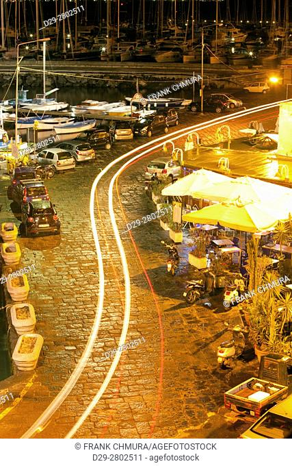 Marina Grande, Procida Island, Italy - traffic and restaurants in the evening