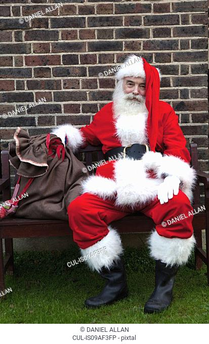 Santa Claus taking break on bench
