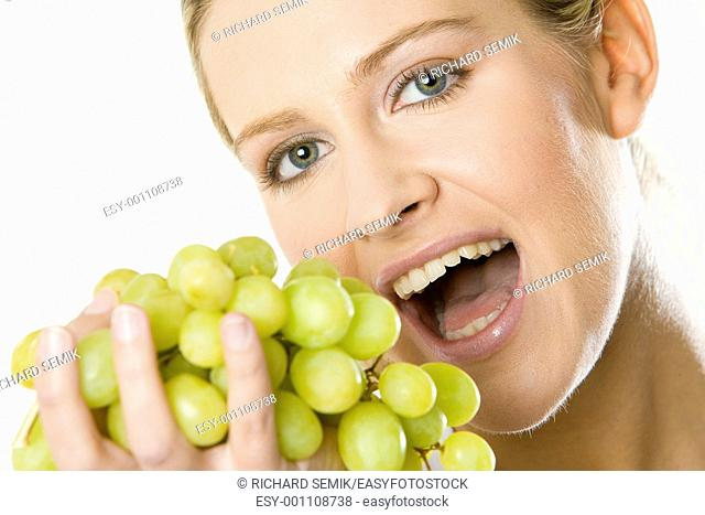 portrait of woman with grape