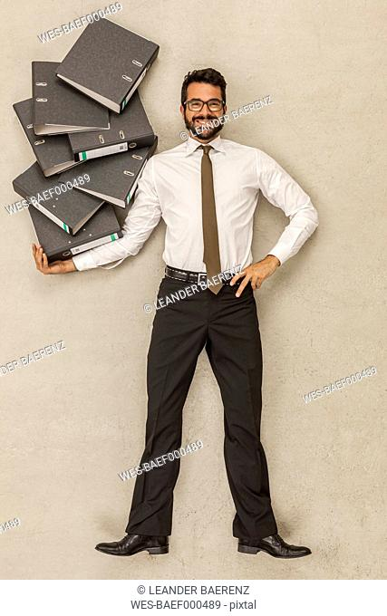 Businessman holding stack of files