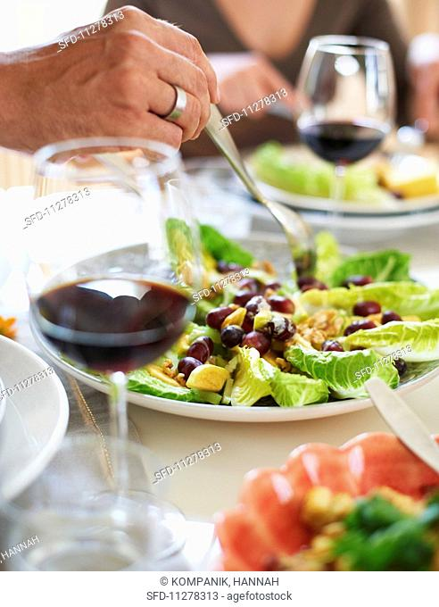 A Waldorf salad on a table laid for Thanksgiving