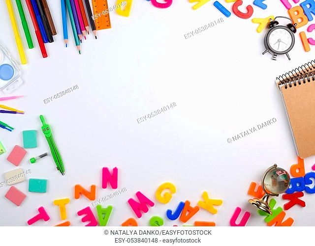 set of different school colorful items for learning at school on a white background, the middle space, top view, concept of back to school