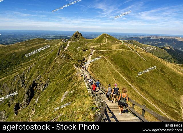 Hikers on way to top of Puy de Sancy, Auvergne Volcanoes Natural Park, Puy de Dome department, Auvergne-Rhone-Alpes, France, Europe