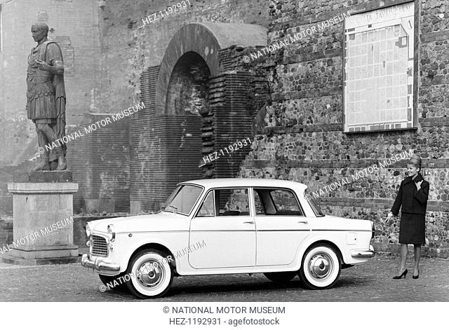 1963 Fiat 1100 Speciale, 1960s. Parked by a Roman statue