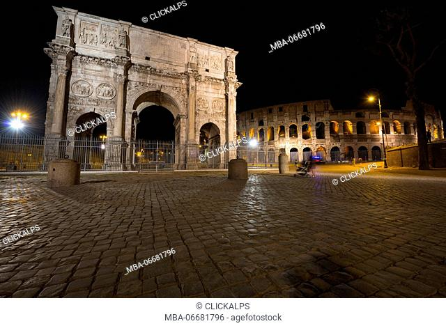 Arch of Costantine and Colosseum by night, Rome, Lazio district, Italy