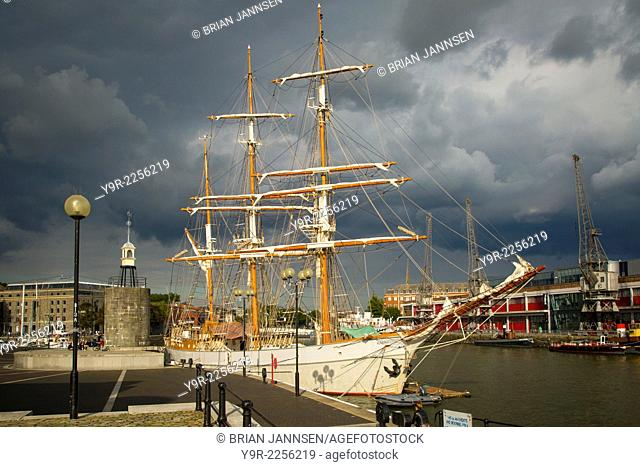Storm clouds hover over the SS Kaskelot in the harbor at Bristol, England