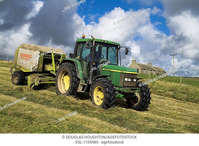 HARVESTING FARMING Tractor baler baling dry silage grass and cottage Orphir Orkney