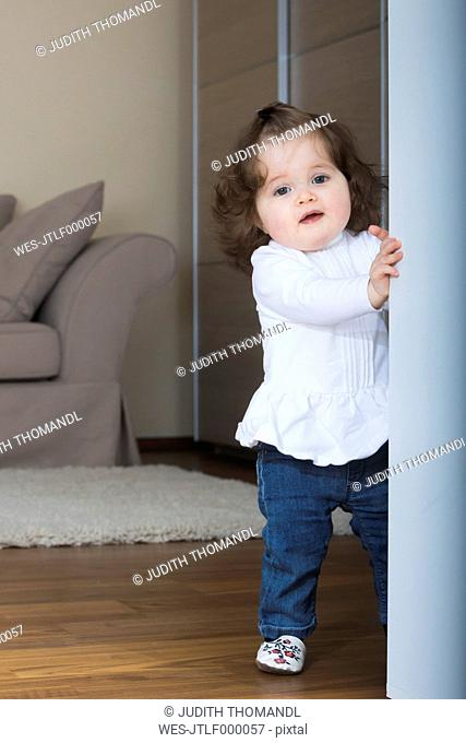 Little girl trying first steps