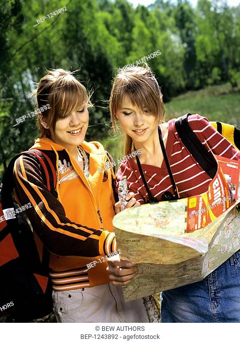 Two girls with map