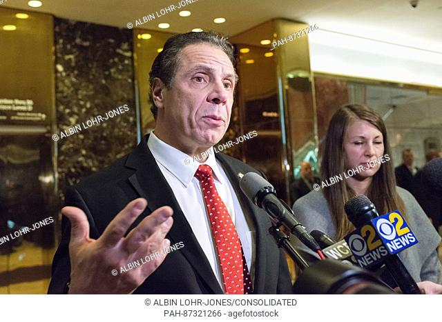 New York State Governor Andrew Cuomo is seen speaking with reporters in the lobby of Trump Tower in New York, NY, USA following his meeting with President-elect...