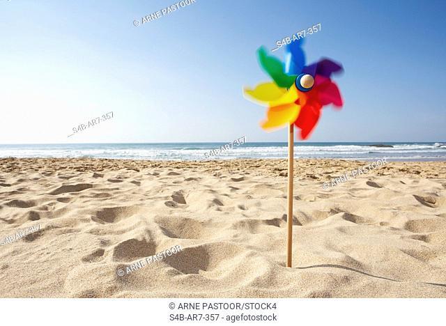 Pinwheel on the beach, Odeceixe, Algarve, Portugal