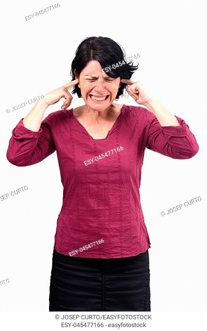 woman making noise hurting her ears on white background