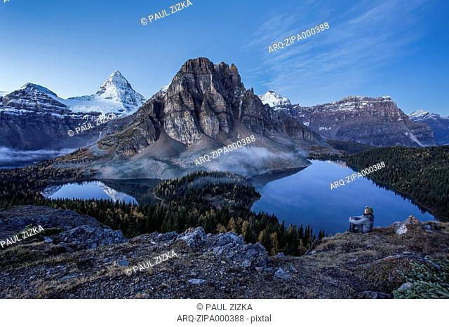 Man Overlooking Lake At Mount Assiniboine Provincial Park, British Columbia, Canada