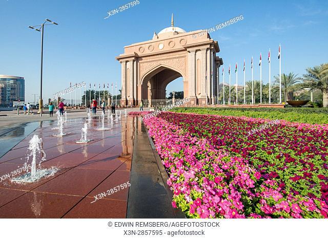 Emirates Palace Abu Dhabi; Dubai; United Arab Emirates - Stone archway and rows of petunias in Abu Dhabi