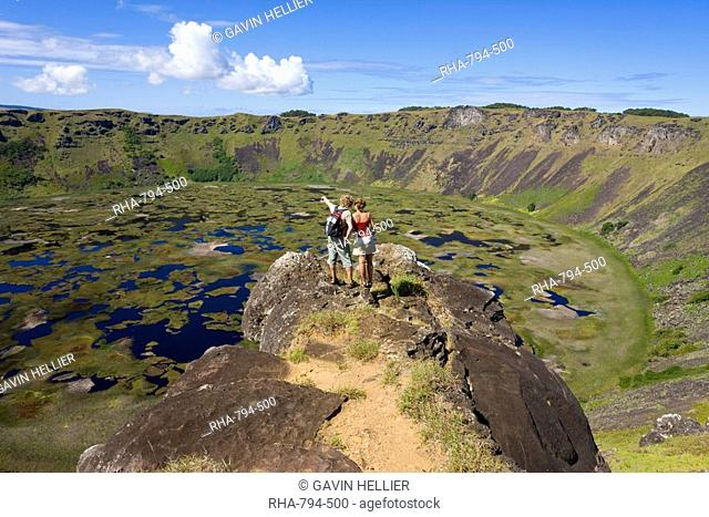Tourists looking into the crater and view from the rim into the crater of Ranu Kau, Rapa Nui Easter Island, Chile, South America