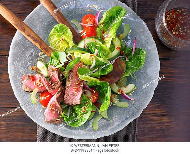 Hot Thai salad with steak strips