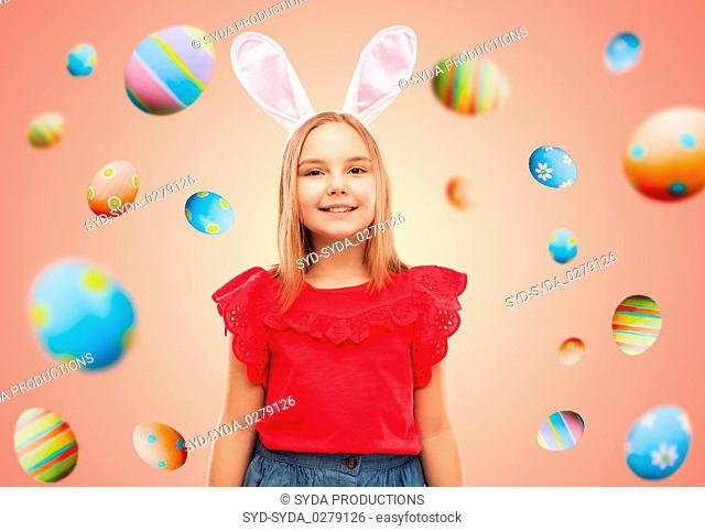 happy girl wearing easter bunny ears headband