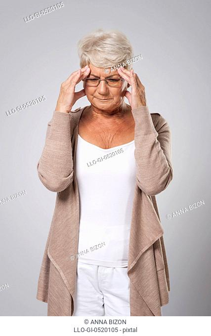 Senior woman with huge pain of head. Debica, Poland