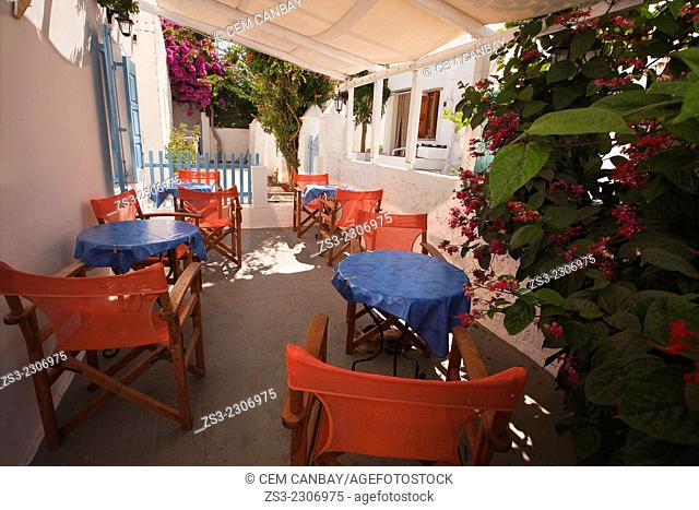An open-air cafe with colorful chairs and tables in the old town Hora, Folegandros, Cyclades Islands, Greek Islands, Greece, Europe