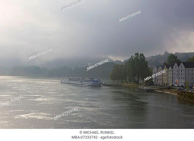 Cruise ship paasing on the Danube in the early morning mist, Passau, Germany