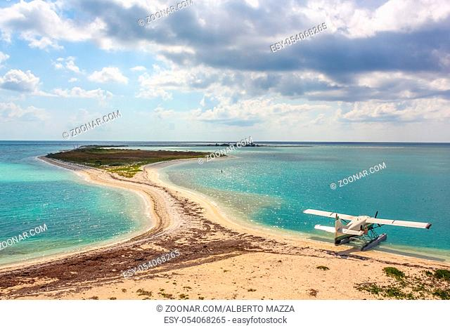 Sea plane docking at Dry Tortugas.Dry Tortugas, is the National Park, less visited of the United States because it is located 70 miles from Key West in Florida...