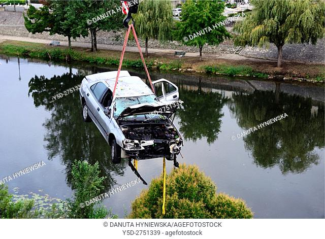 crane lifting crashed car over Isle River, Perigueux, Dordogne, Aquitaine, France , Europe