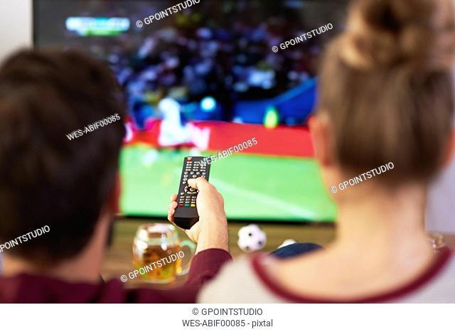 Couple watching football match on Tv