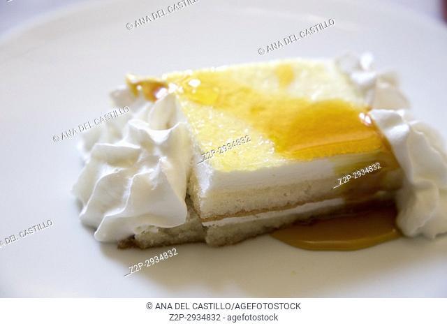 Lemon tart with honey on plate