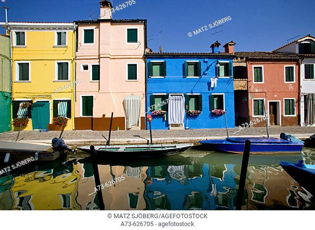 Laguna (lagoon) di Venezia. Burano. A canal with the typical colourful houses. Venice. Italy
