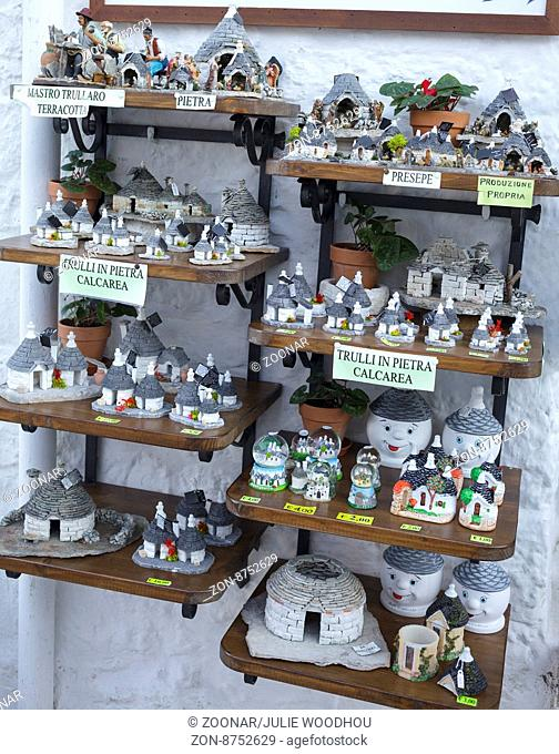 Miniature trulli souvenirs outside a shop in Alberobello, Puglia, Italy