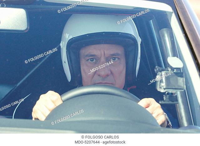 Actor and TV host Claudio Bisio driving a car in the backstage of the TV show Top Gear Italia. Italy, 1st March 2016