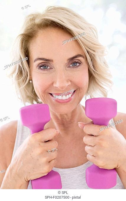Mature woman using hand weights