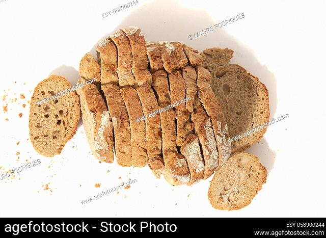 Traditional slices of grain seed bread on white background