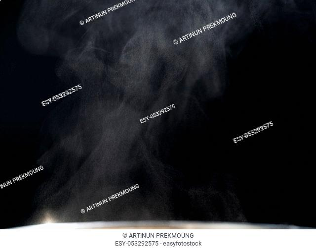 White and gray steaming on black abstract background with copy space for text