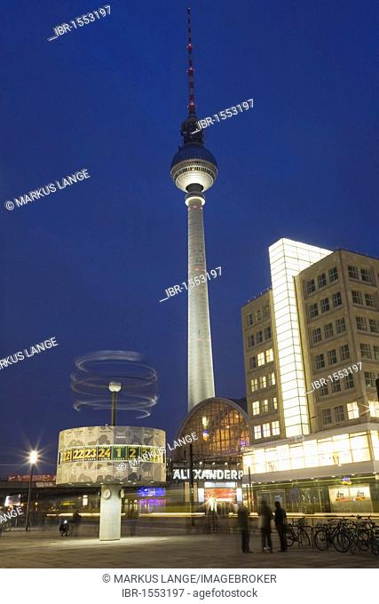 World clock and the Fernsehturm television tower at Alexanderplatz square, Berlin, Germany, Europe