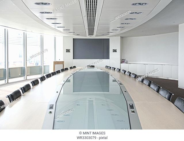 Television and large table in modern conference room