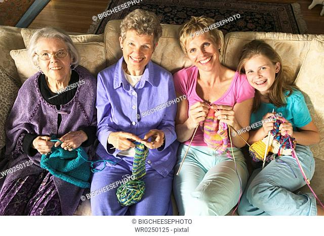 Four generations of females knitting