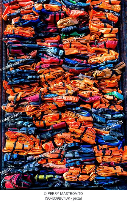 Colourful stacked migrant lifejackets exhibition - Soleil Levant by Chinese artist Ai Weiwei, Nyhavn, Copenhagen, Denmark