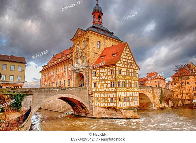 The Old Town Hall (1386) of Bamberg(Germany) was built in the middle of the Regnitz river, accessible by two bridges . The Old Town of Bamberg is listed as a...