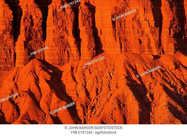 Sunset reddens sandstone cliffs, west side, Capitol Reef National Park, Utah, USA
