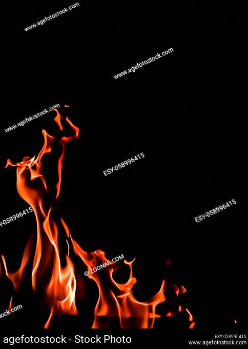 Flames of fire on a black background. Space for copy, text, your words. Vertical