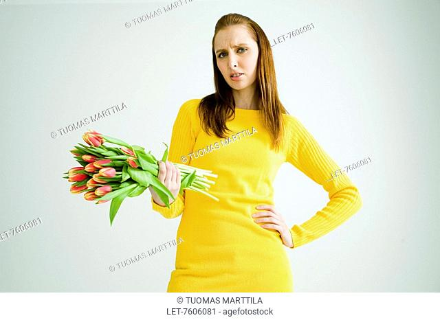 Angry woman with bunch of tulips