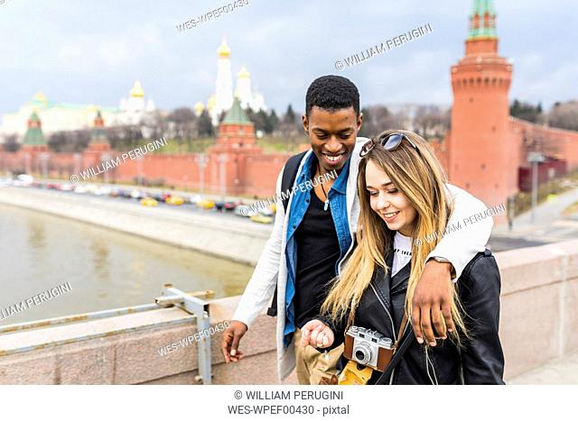 Russia, Moscow, multiracial couple in the city