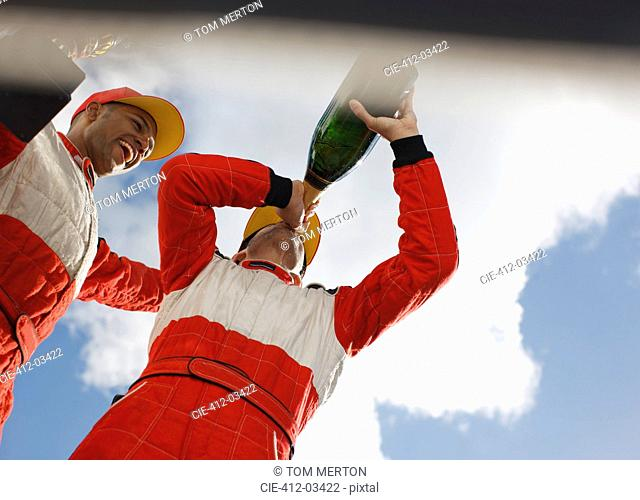 Racer drinking champagne on track
