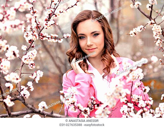 Pretty, gentle, soft, cute, sweet, nice, relax, peaceful, happy, lonely, vivid, smiling, gorgeous very beautiful girl, garden full of flowering apples, cherries