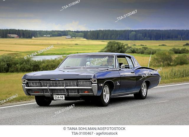 VAULAMMI, FINLAND - AUGUST 4, 2018: Classic black Chevrolet Impala car, likely late 1960s, on Maisemaruise 2018 car cruise in Tawastia Proper, Finland