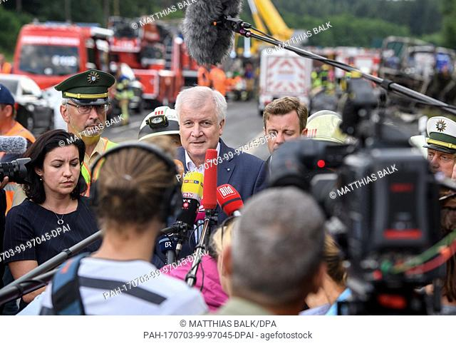 Horst Seehofer (CSU), the premier of the state of Bavaria, talks to journalists at the site of an accident involving a coach on the A9 motorway near...