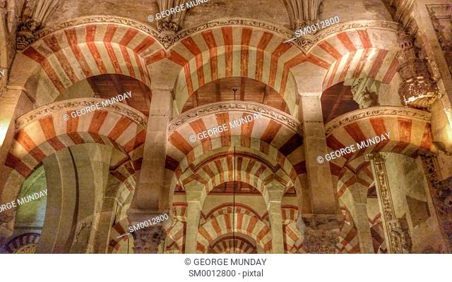 Arabic Arches in the Prayer Hall in the 10th Century Mezquita Mosque, . Cordoba City, Province of Cordoba, . Andalucia, Spain
